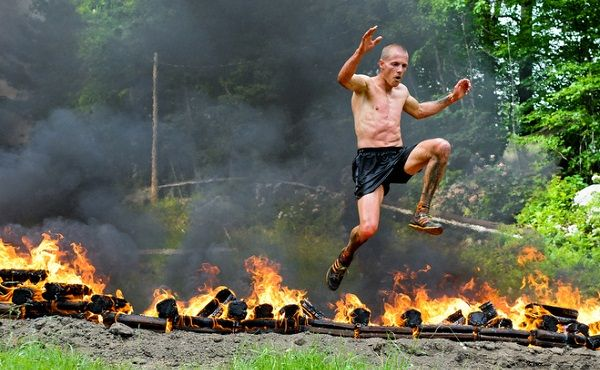 Hobie Call jumps over flames in a Spartan RaceCREDIT: Nuvision Action Images