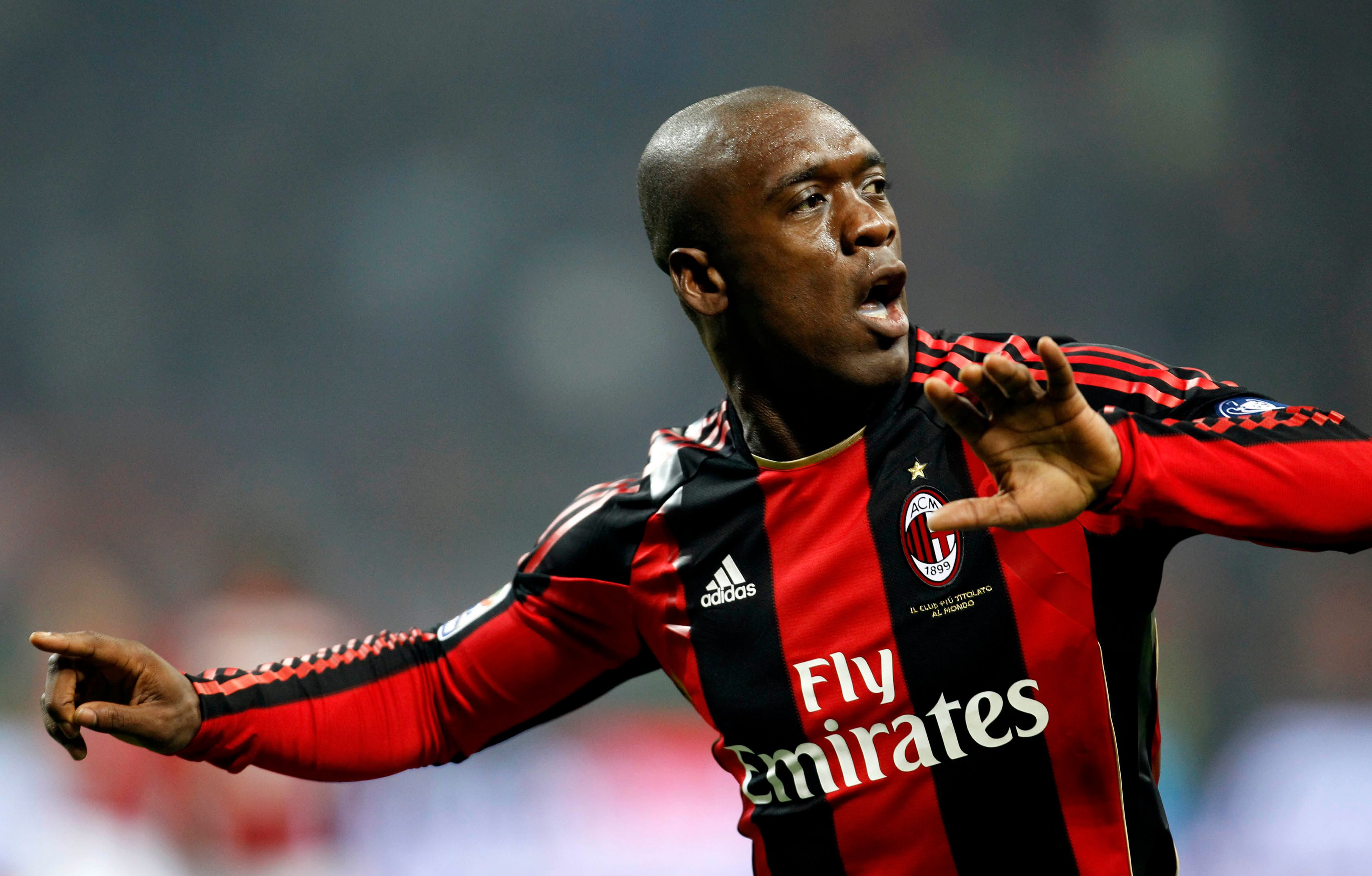 AC Milan's Seedorf celebrates after scoring against Parma during their Italian Serie A soccer match in Milan