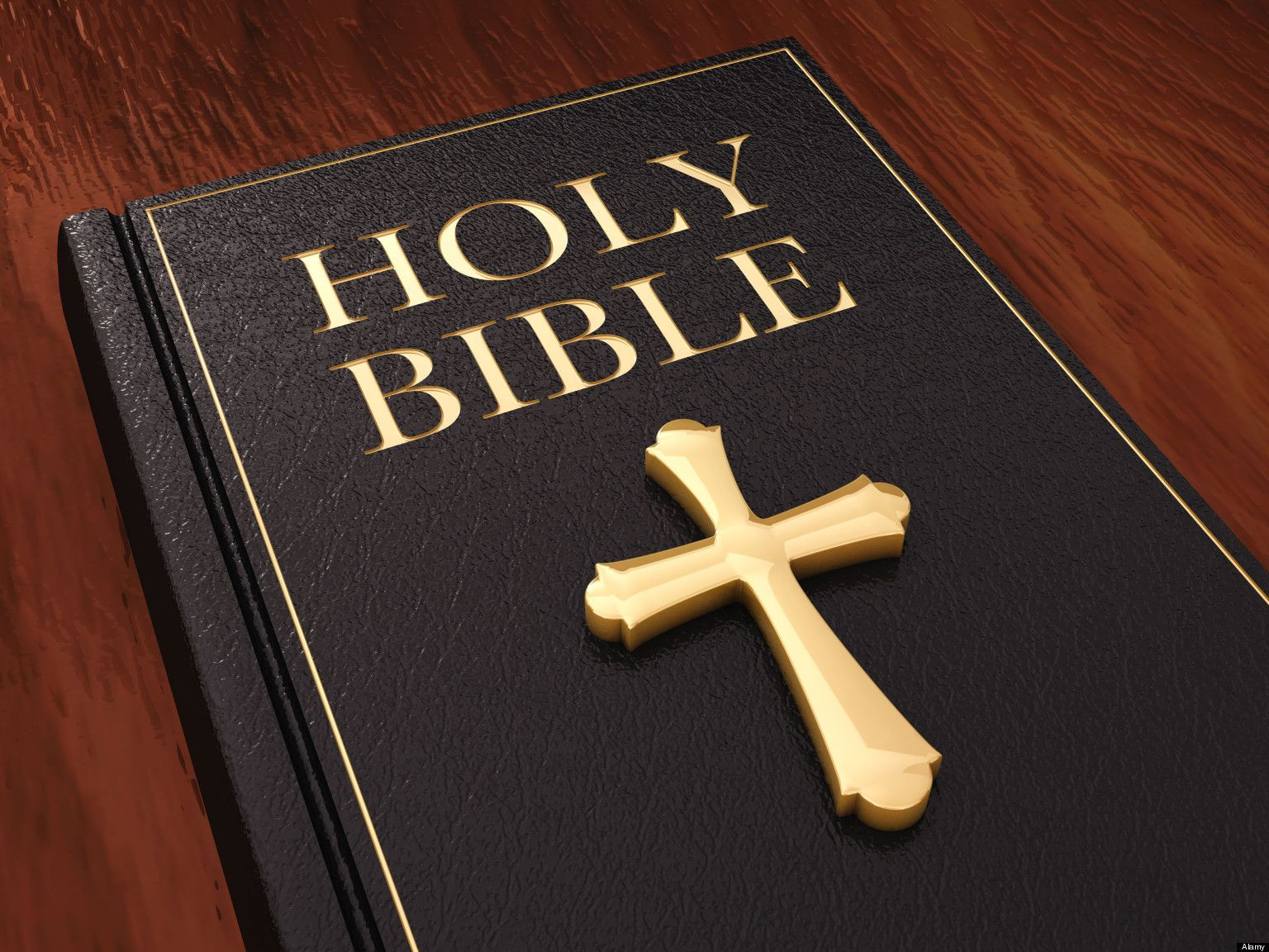 Golden cross and black leather bible