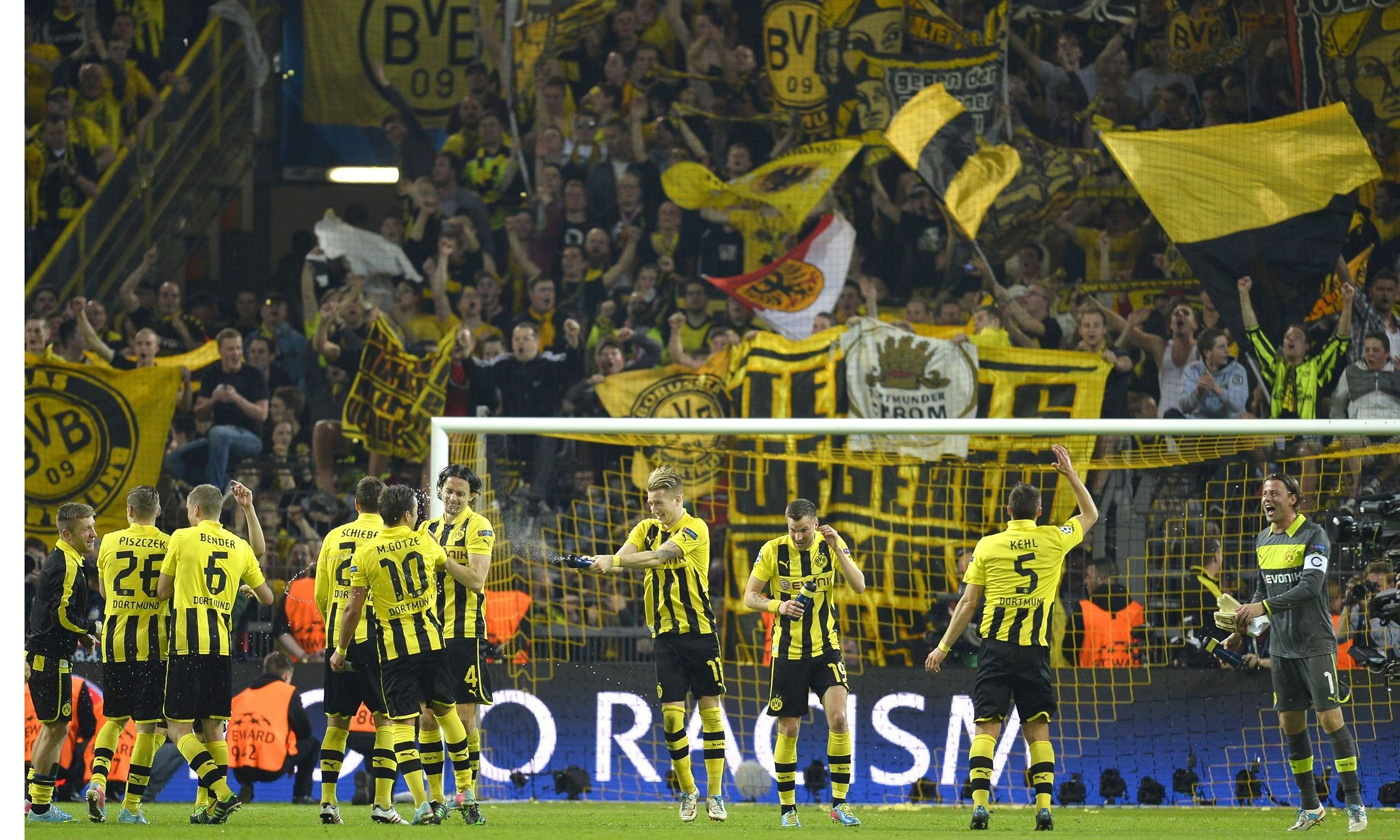 Dortmund players and fans celebrate the 4-1 Champions League win against Real Madrid in April.