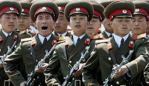 A North Korean military honor guard marches past d